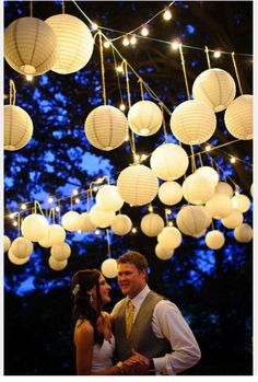 outdoor wedding lighting using paper rice lamps from IKEA
