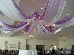 Purple and White Swags #purpleandwhite #fabricswags #ceilingswags #fabricdrape #weddingdecor #michiganweddings #ColonialEvents