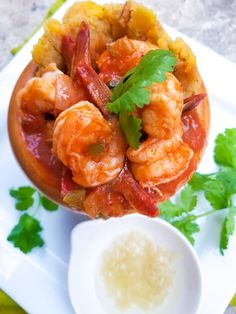 Mofongo con Camarones or Mofongo de Camarones (Mofongo with Shrimps) is a hyper delicious Puerto Rican dish made with a garlic plantain mash and served with shrimps in a salsa criolla sauce. One of the best dishes you will ever have! Mofongo Recipe, How To Cook Plantains, Mashed Plantains, Puerto Rican Dishes, Pollo Chicken, Fried Pork, Best Dishes, Food To Make, Shrimp
