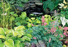 Instead of clumping your hostas together, mix in shade lovers with contrasting foliage and flowers. Here, coralbells (Heuchera), creeping Jenny (Lysimachia), and fringed bleeding heart (Dicentra) make for a pretty vignette with lots of visual interest. via Lowe's Creative Ideas