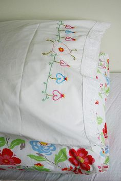 Embroidered pillowcases  -  I was given some of these when I got married in the 70s by aunts who did a lot of embroidery, so pretty, something you just don't see much of anymore.