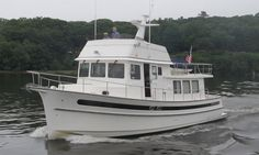 """The Nordic Tugs Nordic Tug 49 has a LOA of 52'3'' (15.93 m) and a beam of 16'1"""" (4.90 m)."""