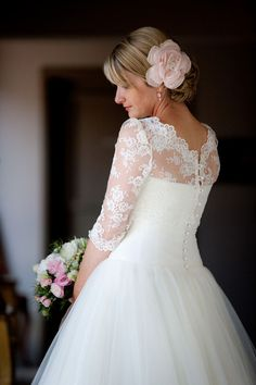 i adore this little backwards bolero. she takes it off and has a strapless dress for the reception.