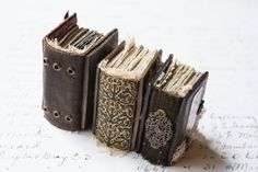 JEWELRY / CURIOSITY KEEPERS: tiny handmade books made into necklaces - should actually be able to write on the pages.