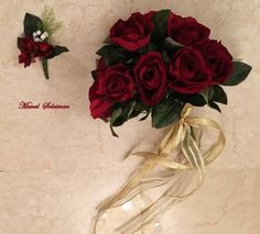 Red roses#Wedding #bouquet with #golden #ribbon.New #floral #design from #ManalSolaiman@wardyfloral.