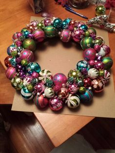 If I could find vintage ball ornaments I would do this!