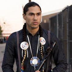 Martin Sensmeier wears quill hair ties and medallion by Lakota artists Ista Ska.