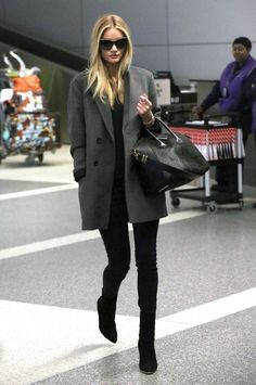 Model and actress Rosie Huntington-Whiteley arriving on a flight at LAX airport in Los Angeles, California on February 28, 2014.