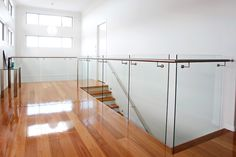 Sophisticated materials converge to create contemporary balustrades. Patio Railing, Stair Railing Design, Railing Ideas, Staircase Ideas, Glass Stairs, Wood Stairs, Stainless Steel Staircase, Glass Railing System, Modern Properties