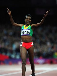 Ethiopia's Tirunesh Dibaba celebrates as she crosses the finish line in the women's 10,000m Final on Day 7 of the London 2012 Olympic Games.