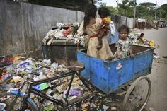 Children play in a rickshaw at a garbage dump in Hyderabad, India on Tuesday, Nov. 17.  Children of the World (25 pics + text)