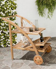 Whether it's time for tea or a backyard dinner party, this portable Lodi outdoor serving cart is the perfect helper. It makes serving snacks and beverages easy and looks great while doing it. Crafted from strong, beautiful acacia wood, the cart features a teak brown finish for distinct style.