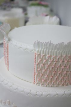 Smocking technique...O.my.word!!!! My favorite clothing item for LG in cake form!!! Would be incredibly adorable for her first birthday cake!!!