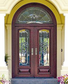 """Door Style DbyD-1056.  This lovely Front Exterior Entry has Double Mahogany Style """"E-2"""" Doors with a Radius Transom.  Doors by Decora designed and built the Custom Leaded, Beveled and Textured Glass."""