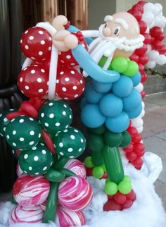 christmas balloon arch and holiday decorations