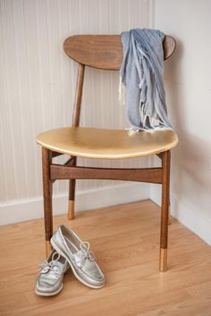 Gold-Dipped chair legs with natural wood stain