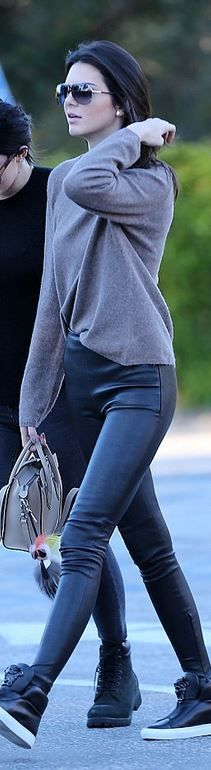 Who made Kendall Jenner's black leather pants, sneakers, handbag, and key chain?