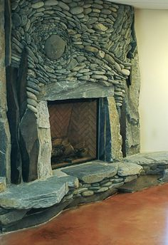 "VanGogh's Starry Night rendered in stone.  Natural Stone Fireplace - ""Norma Rae"" - www.AncientArtofStone.com — at Nanaimo Ice Centre."