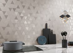 11 types of white kitchen splashback tiles: Add interest with shape over colour - STYLE CURATOR White kitchens don't have to be boring, especially when you add visual texture with interesting tile shapes. Here are 11 white kitchen splashback tiles. Modern Kitchen Tiles, Kitchen Splashback Tiles, Kitchen Tiles Design, Modern Kitchen Design, Kitchen Walls, Wall Tiles For Kitchen, Room Wall Tiles, Splashback Ideas, Backsplash Tile