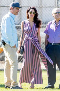 Amal Clooney stuns in a lavender striped Tome jumpsuit while visiting George Clooney on set of Suburbicon in Los Angeles on October 21, 2016.