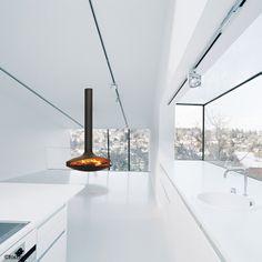 #cheminee gyrofocus  foyer central suspendu pivotant à bois #design contemporain