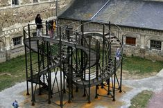 'Revolution' - public art by Michel de Broin (2010);  at Couvent des Jacobins, Rennes, France;  5 stories high;  the 131 feet long staircase forms a knot, allowing one to 'enter an infinite cycle of revolutions';  26 x 16 x 21 feet