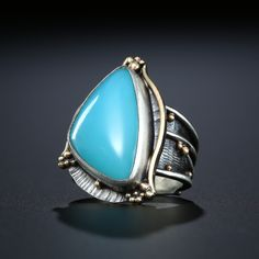 Metalsmiths Amy Buettner and Tucker Glasow. Blue Chalcedony Ring. Fabricated Sterling Silver and 14k. www.amybuettner.com Antique Jewelry, Silver Jewelry, Cowgirl Bling, Knuckle Rings, Blue Chalcedony, Turquoise Rings, Native American Jewelry, Ring Earrings, Indian Jewelry