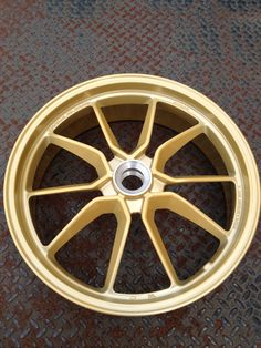 Ducati rim turned from black into gold.  Midas touch baby!  Work by Architectural Elements/367 Customs.