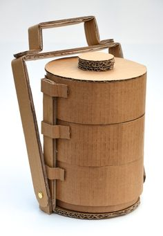 You've probably heard of tiffin carriers, and even seen the modern plastic/melamine ones for sale alongside bento boxes and o. Smart Packaging, Tea Packaging, Food Packaging Design, Packaging Design Inspiration, Sushi Take Out, Tiffin Carrier, Tiffin Box, Cardboard Furniture, Cardboard Art