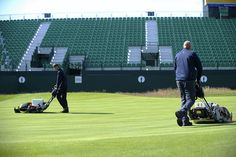 Grounds crew at Royal Liverpool Golf Club in Hoylake, England, prepping the greens for the 2014 Open Championship