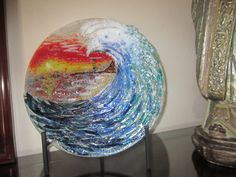 this piece is hand cut & glass painted then fired in several layers to create the depth . by Dianne Taylor