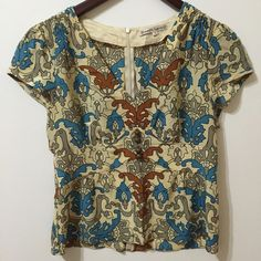 Nanette Lepore Blouse 100% silk. Good condition and ready for a new home Nanette Lepore Tops Blouses