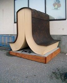 Open Book - Castlegar, British Columbia  --  Had to stop and look at this very unique bench. How appropriate that it is an open book, inviting one to sit with a good book, or just ponder the passersby.    --    The bench is by artist: Paul Reimer