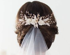 Image result for bridal hair with veil
