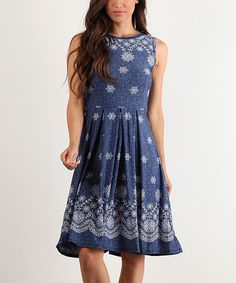 Take a look at this Blue & White Paisley Sleeveless Dress today!