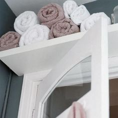 LOVE this idea of a shelf over the cainet in the bathroom.  Place to put extra towels! Use this idea with the cainet and towl bar over the toilet.  Two towel hooks can go on oposite wall for hanging after a shower.