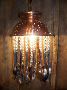Colander Chandelier with silverware. This is perfect for additional lighting over the kitchen island if i dont hang pots and pans instead