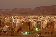 """World's Oldest Skyscrapers Shibam, a town in Hadramawt, Yemen, is considered to have the world's oldest skyscrapers. It has about 7,000 inhabitants and all of the town's houses are made out of mud bricks. Some of these structures rise 5 to 9 stories high. Most of the city's houses come from the 16th century. Shibam is often called """"the Manhattan of the desert""""."""