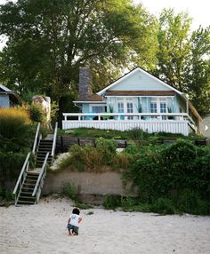 Exterior of Teresa Wiwchar's beach home, Lake Erie, Southwestern Ontario. Via the House of Turquoise Beach Cottage Style, Beach Cottage Decor, Coastal Cottage, Coastal Style, Seaside Style, Coastal Living, House Of Turquoise, Turquoise Cottage, Cottages By The Sea