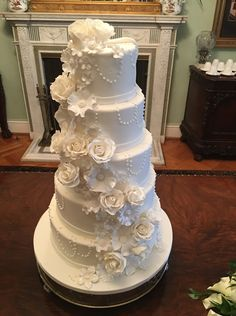 Roses, wildroses and blossoms tumble down a cake with piped pearls - and the other side was Super Hero's!!! Create A Cake, Party Cakes, Blossoms, Roses, Bride, Pearls, Elegant, How To Make, Wedding