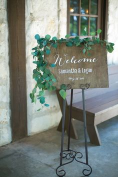 Gorgeous welcome wedding sign! Love the greenery around the frame for a natural look. Taken at THE SPRINGS in The Woodlands. Follow this pin to our website for more information, or to book your free tour! Photographer: Tru Identity Photography #welcomeweddingsign #weddingsign #weddingsignideas #wedding #weddingideas #weddingdetails #bohowedding #naturalwedding #bohemianwedding #bohemianweddingideas