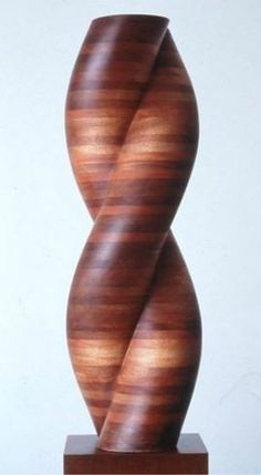 Gemini Sculpture By Jack Youngerman size 11.5x36x7 mahogany wood created in 1994.