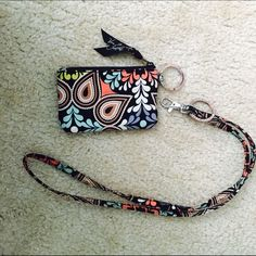 Vera Bradley lanyard Selling my Vera Bradley lanyard and matching ID holder, both were used for a very short time and are in great condition! Please make all offers through the offer button :-) Vera Bradley Accessories Key & Card Holders