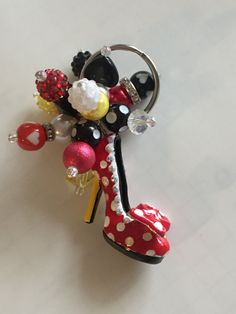 Wow, so pretty! Definitely a must have accessory. This READY TO SHIP keychain features a red and white polka dot 3D shoe. This is a designer pendant. I have wire wrapped several beads to the keychain with the use of split rings. Details: 12 mm red, white, black and yellow beads Secure!  Questions? Custom requests? Message me :)