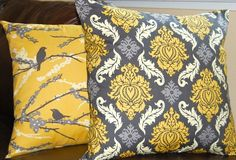 Yellow and gray are so hot right now. Love the damask pattern. @megan henderson dontcha think these are screaming for a place on your new couch?!