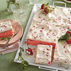"Strawberries-and-Cream Sheet Cake | Trust us: This simple and swoon-worthy sheet cake will be a keeper in your recipe box. File it under ""Springtime Crowd-pleaser."""