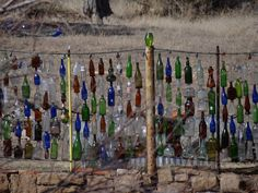 Bottle fence, Madrid, NM, via Flickr.