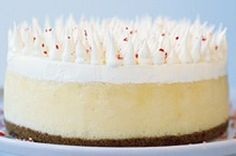Present a show-stopping dessert with our White Chocolate-Candy Cane Cheesecake. White Chocolate-Candy Cane Cheesecake is a beautiful, minty delight. Peppermint Cheesecake, Christmas Cheesecake, Christmas Desserts, Christmas Baking, Christmas Treats, Christmas Cookies, Christmas Foods, Christmas Candy, Holiday Treats
