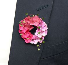 Our unique, elegant boutonnieres for the groom beautifully complement the bride's bouquet.