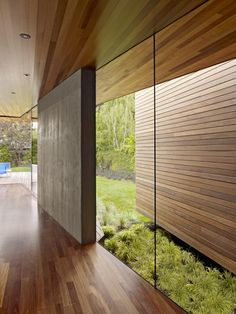 floor to ceiling glass. curved. With inside and out mixing together. Idea noted. Use of wood a bit excessive though.